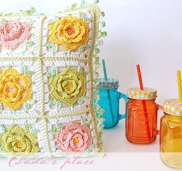 Colorful flowery crochet pillow
