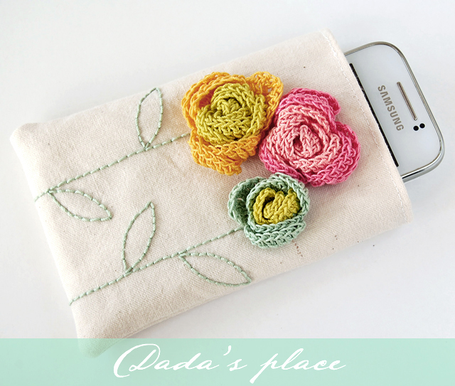 Phone pouch with crochet flowers