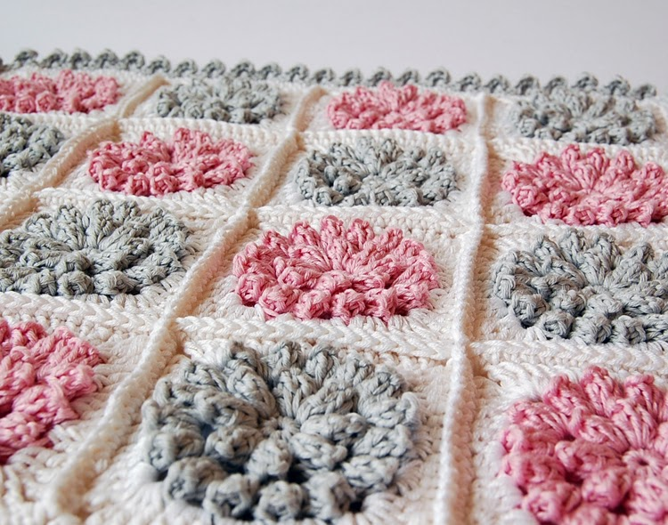 Pink and gray flowery crochet pillow case