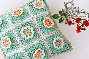 A crochet pillow that makes me smile